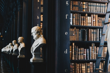 Library with old books and busts of men